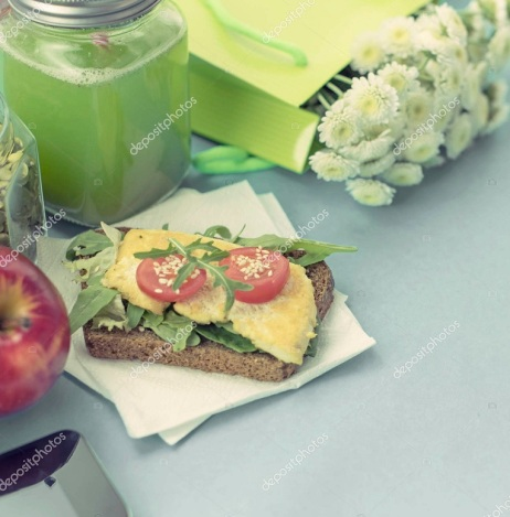 Healthy vegetarian Breakfast. Sandwich grain bread tofu cheese, detox smoothie, pumpkin seeds, cherry tomatoes, natural flowers, blue background, notebook. Lunch box with soup for lunch